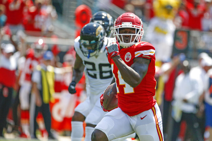 Kansas City Chiefs wide receiver Sammy Watkins, right, runs past Jacksonville Jaguars defensive back Jarrod Wilson (26) for a 68-yard touchdown on a pass play during the first half of an NFL football game, Sunday, Sept. 8, 2019, in Jacksonville, Fla. (AP Photo/Stephen B. Morton)