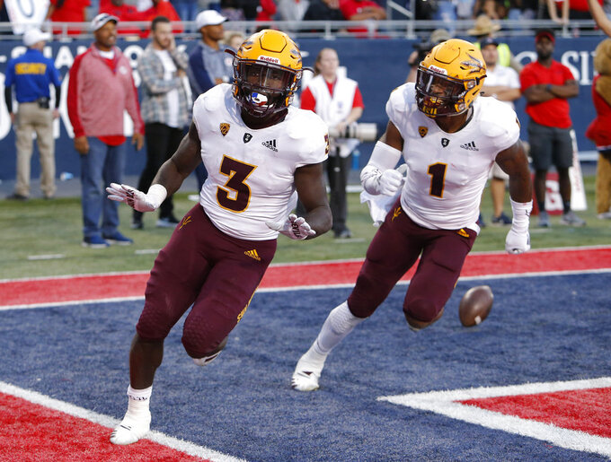 Arizona State running back Eno Benjamin (3) celebrates with N'Keal Harry after scoring the winning touchdown during an NCAA college football game against Arizona, Saturday, Nov. 24, 2018, in Tucson, Ariz. (AP Photo/Rick Scuteri)