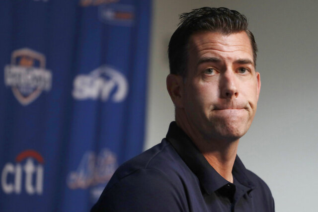 FILE - In this Feb. 14, 2019, file photo, New York Mets general manager Brodie Van Wagenen pauses while speaking to the media following spring training baseball practice in Port St. Lucie, Fla. Van Wagenen and many of his top aides are out, moves announced less than an hour after hedge fund manager Steve Cohen completed his $2.4 billion purchase of the team Friday, Nov. 6, 2020.   (AP Photo/Jeff Roberson, File)