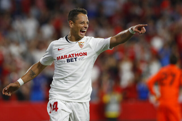 "FILE - In this Oct. 3, 2019, file photo, Sevilla's Javier Hernandez celebrates after scoring his side's opening goal during a Europa League group A soccer match against APOEL Nicosia at the Estadio Ramon Sanchez-Pizjuan stadium in Seville, Spain. The Los Angeles Galaxy have signed Javier ""Chicharito"" Hernández to a Designated Player contract, the MLS soccer club announced Tuesday, Jan. 21, 2020. (AP Photo/Miguel Morenatti, File)"