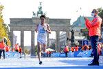 Japan's Hidekazu Hijikata runs to the finish line in the Berlin Marathon in Berlin, Germany, Sunday, Sept. 26, 2021. (AP Photo/Lisa Leutner)