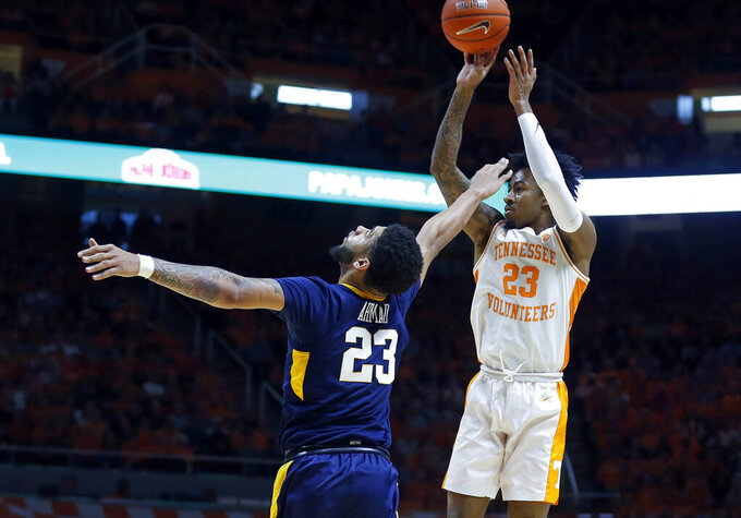 Tennessee guard Jordan Bowden (23) shoots over West Virginia forward Esa Ahmad (23) in the second half of an NCAA college basketball game Saturday, Jan. 26, 2019, in Knoxville, Tenn. Tennessee won 83-66. (AP Photo/Wade Payne)