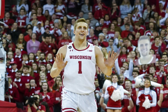 Wisconsin's Brevin Pritzl (1) reacts after hitting a three-point basket against Nebraska during the second half of an NCAA college basketball game Tuesday, Jan. 21, 2020, in Madison, Wis. Wisconsin won 82-68. (AP Photo/Andy Manis)