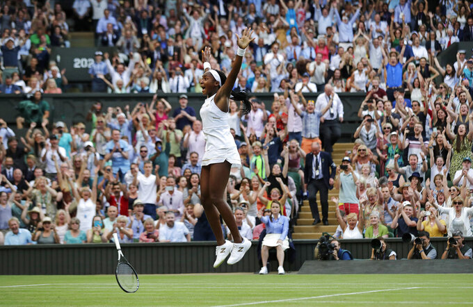 "United States' Cori ""Coco"" Gauff celebrates after beating Slovenia's Polona Hercog in a women's singles match during day five of the Wimbledon Tennis Championships in London, July 5, 2019. (AP Photo/Ben Curtis)"