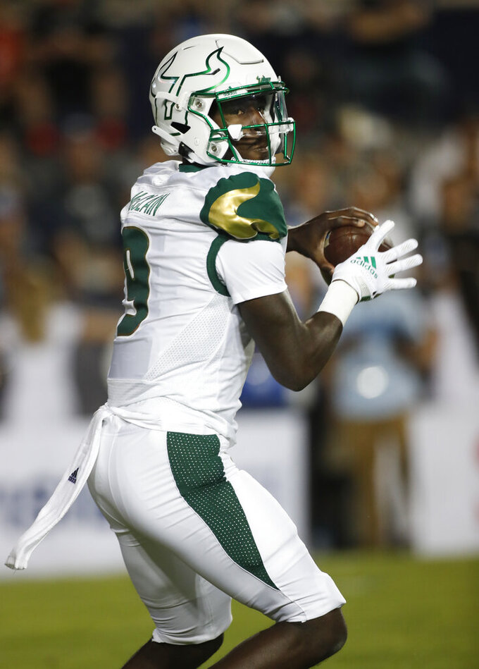 South Florida quarterback Timmy McClain (9) looks to pass the ball in the first half of an NCAA college football game against BYU Saturday, Sept. 25, 2021, in Provo, Utah. (AP Photo/George Frey)