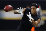 FILE - In this Sunday, Jan. 20, 2019 file photo, New Orleans Saints' Michael Thomas warms up before the NFL football NFC championship game against the Los Angeles Rams in New Orleans. Fans worry that the summer rite in the NFL, training camp holdouts, won't affect their team's chances for a championship. This year's crop of no-shows includes an All-Pro receiver, the Saints' Michael Thomas; a standout offensive tackle who might be the key to the Redskins' offense, Trent Williams; and budding stars DEs Jadeveon Clowney of the Texans, Yannick Ngakoue of the Jaguars, and RB Melvin Gordon of the Chargers.(AP Photo/Gerald Herbert, File)
