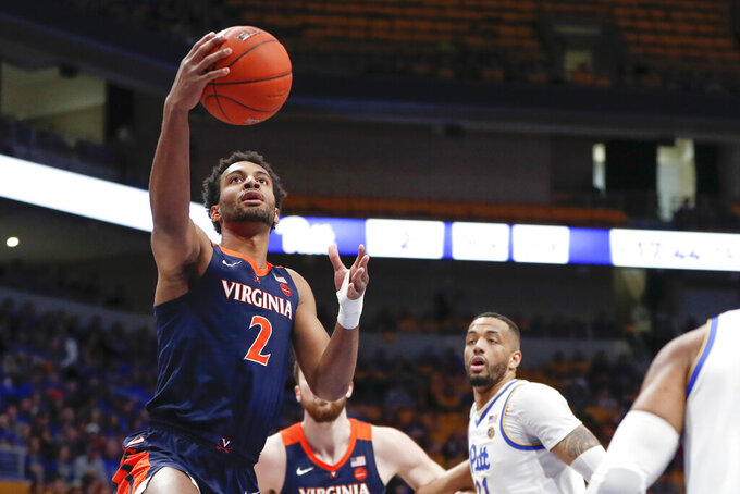 Virginia's Braxton Key (2) shoots after getting by Pittsburgh's Terrell Brown, right, during the first half of an NCAA college basketball game, Saturday, Feb. 22, 2020, in Pittsburgh. (AP Photo/Keith Srakocic)