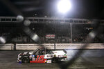 Austin Hill tries to do a burnout after winning the NASCAR Truck Series auto race on the dirt Friday, July 9, 2021, at Knoxville Raceway in Knoxville, Iowa. (Joseph Cress/Iowa City Press-Citizen via AP)