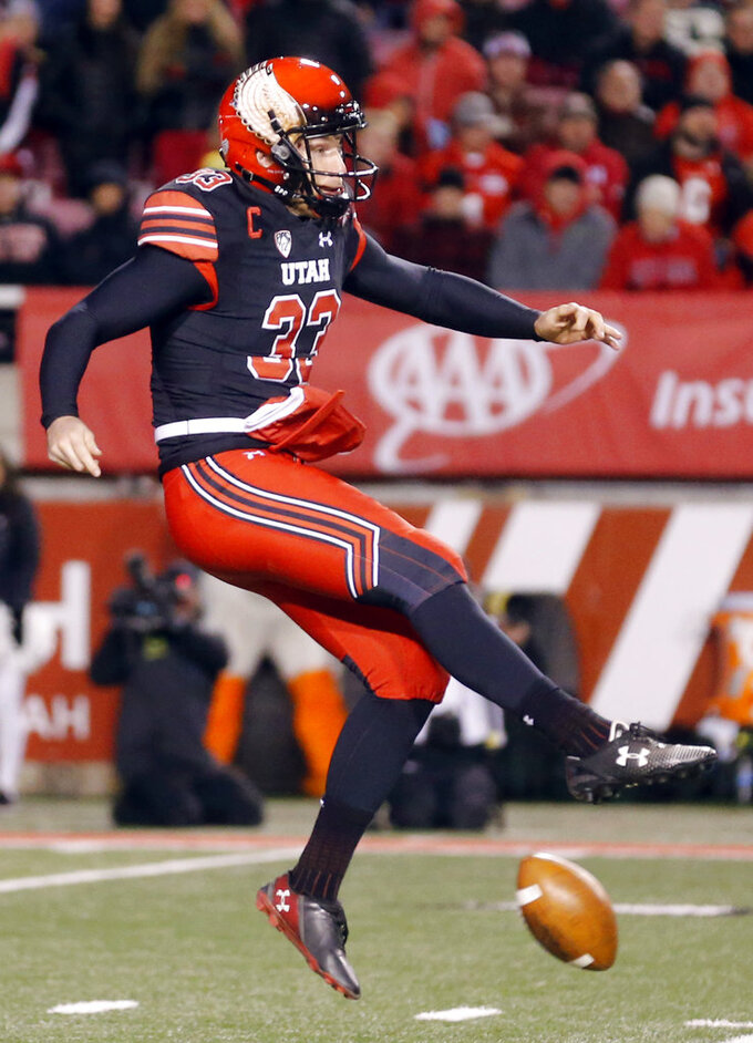 Utah punter Mitch Wishnowsky (33) has his punt blocked in the second half during an NCAA college football game against Oregon, Saturday Nov. 10, 2018, in Salt Lake City. (AP Photo/Rick Bowmer)