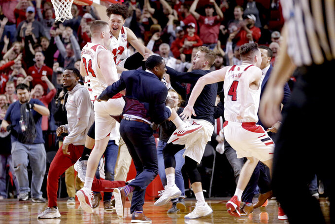 Nebraska players celebrate their win in overtime against Iowa in an NCAA college basketball game in Lincoln, Neb., Sunday, March 10, 2019. (AP Photo/Nati Harnik)
