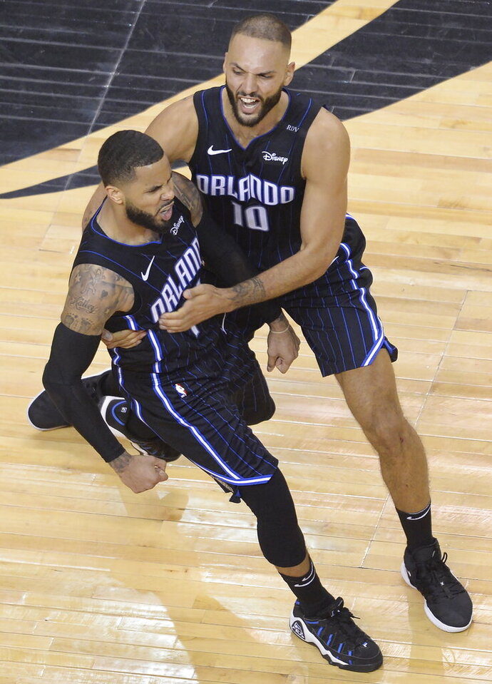 Orlando Magic guard D.J. Augustin (14) celebrates his game-winning three point basket with teammate Orlando Magic guard Evan Fournier (10) late the second half in Game 1 of a first-round NBA basketball playoff series in Toronto, Saturday, April 13, 2019. The Magic won 104-101. (Nathan Denette/The Canadian Press via AP)