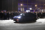 People get into Tesla's Model Y for a test drive at the company's design studio Thursday, March 14, 2019, in Hawthorne, Calif. The Model Y may be Tesla's most important product yet as it attempts to expand into the mainstream and generate enough cash to repay massive debts that threaten to topple the Palo Alto, California, company. (AP Photo/Jae C. Hong)