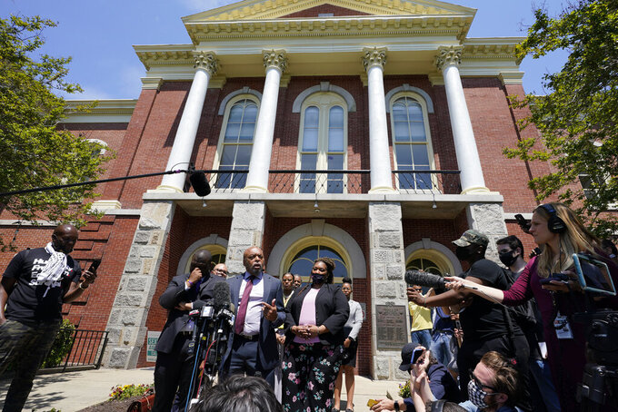 Attorneys for the family of Andrew Brown, Wayne Kendall, at podium, makes comments after a judges decision on the release body cam video of the shooting of Andrew Brown Jr. in Elizabeth City, N.C., Wednesday, April 28, 2021. A judge denied the request to immediately release body cam video of the incident. (AP Photo/Steve Helber)