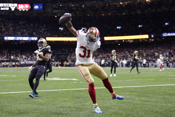 San Francisco 49ers running back Raheem Mostert (31) celebrates a touchdown in the first half an NFL football game against the New Orleans Saints in New Orleans, Sunday, Dec. 8, 2019. (AP Photo/Brett Duke)