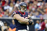 FILE - In this Oct. 27, 2019, file photo, Houston Texans defensive end J.J. Watt (99) reacts after a play against the Oakland Raiders during the first half of an NFL football game, in Houston. Next Monday, the Hall of Fame and the NFL will announce the roster for the 2010-19 All-Decade team.(AP Photo/Michael Wyke, File)