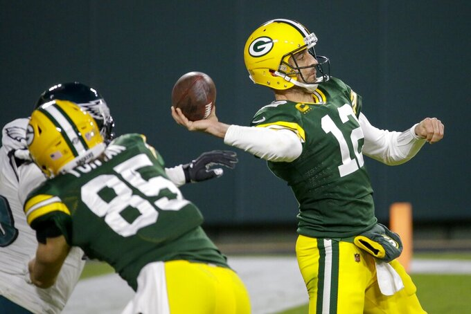 Green Bay Packers' Aaron Rodgers throws a pass during the second half of an NFL football game against the Philadelphia Eagles Sunday, Dec. 6, 2020, in Green Bay, Wis. (AP Photo/Mike Roemer)