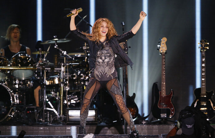 FILE - In this Oct. 11, 2018 file photo, Shakira performs at Azteca Stadium in Mexico City. A Spanish court investigating Shakira for possibly evading 14.5 million euros (16.4 million dollars) in taxes has called on the pop music star to testify in mid-June, 2019. Prosecutors charged the singer in December for not paying taxes in Spain between 2012 and 2014, when she lived mostly in the country despite an official residence in Panama. (AP Photo/Marco Ugarte, File)