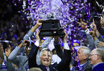 Kansas State head coach Bruce Weber holds the Big 12 trophy following an NCAA college basketball game against Oklahoma in Manhattan, Kan., Saturday, March 9, 2019. Kansas State defeated Oklahoma 68-53. Kansas State shares the regular season title with Texas Tech. (AP Photo/Orlin Wagner)