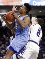 Columbia guard CJ Davis, left, drives to the basket against Northwestern guard Ryan Greer during the first half of an NCAA college basketball game Sunday, Dec. 30, 2018, in Evanston, Ill. (AP Photo/Nam Y. Huh)