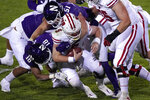 Wisconsin quarterback Graham Mertz (5) is sacked by Northwestern cornerback Cam Ruiz, left, and linebacker Blake Gallagher during the second half of an NCAA college football game in Evanston, Ill., Saturday, Nov. 21, 2020. Northwestern won 17-7. (AP Photo/Nam Y. Huh)