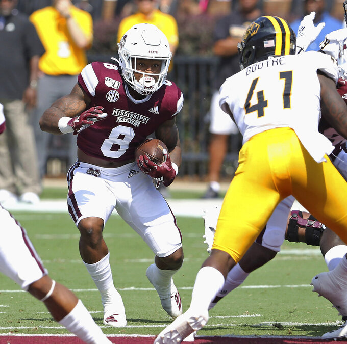 Mississippi State running back Kylin Hill (8) looks for a way past Southern Mississippi linebacker Racheem Boothe (41) during the first half of an NCAA college football game Saturday, Sept. 7, 2019, in Starkville, Miss. (AP Photo/Jim Lytle)