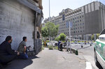 FILE - In this June 7, 2017, file photo, security personnel take position in front of Iran's parliament building after an assault of several attackers, in Tehran, Iran. Iran said Saturday, July 7, 2018, it executed eight people convicted in the 2017 Islamic State group attack on parliament and the shrine of Ayatollah Ruhollah Khomeini in Tehran. (Omid Vahabzadeh/Fars News Agency via AP, File)