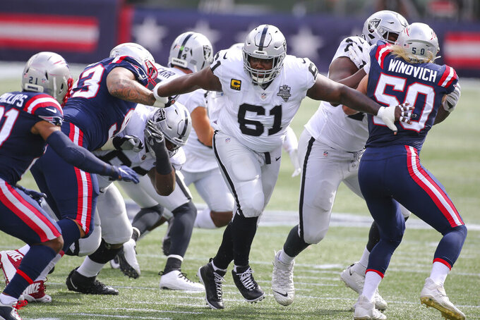 FILE - In this Sunday, Sept. 27, 2020 file photo, Las Vegas Raiders center Rodney Hudson (61) during the first half of an NFL football game against the New England Patriots in Foxborough, Mass. The Arizona Cardinals made a pair of big offseason moves, adding seven-time Pro Bowl receiver A.J. Green on a one-year deal and trading for three-time Pro Bowl center Rodney Hudson.  (AP Photo/Stew Milne, File)