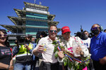 Helio Castroneves, of Brazil, celebrates winning the Indianapolis 500 auto race at Indianapolis Motor Speedway with Mike Shank, Sunday, May 30, 2021, in Indianapolis. (AP Photo/Darron Cummings)