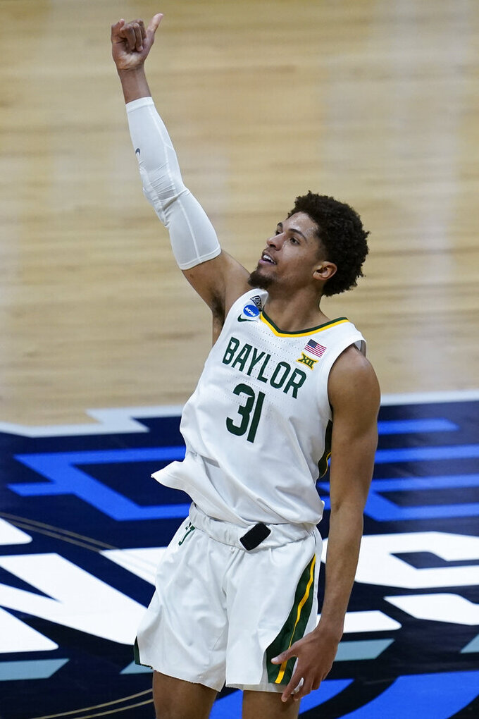Baylor guard MaCio Teague celebrates after making a 3-point basket during the second half of an Elite 8 game against Arkansas in the NCAA men's college basketball tournament at Lucas Oil Stadium, Monday, March 29, 2021, in Indianapolis. (AP Photo/Michael Conroy)