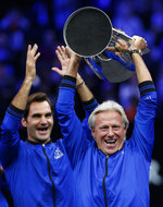 Team Europe's Bjorn Borg, right, and Roger Federer celebrate with the Laver Cup after defeating Team World, Sunday, Sept. 23, 2018, in Chicago. (AP Photo/Jim Young)