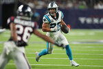Carolina Panthers running back Christian McCaffrey (22) rushes for a gain as Houston Texans cornerback Vernon Hargreaves III (26) defends during the first half of an NFL football game Thursday, Sept. 23, 2021, in Houston. (AP Photo/Eric Christian Smith)