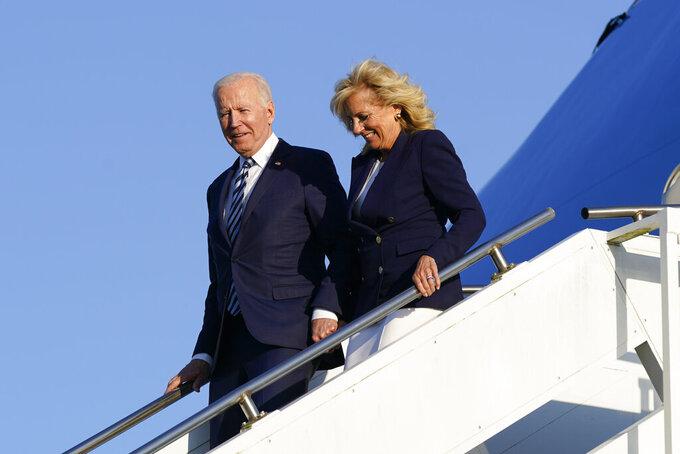 President Joe Biden and first lady Jill Biden step off Air Force One at RAF Mildenhall in Suffolk, England, Wednesday, June 9, 2021. (AP Photo/Patrick Semansky)