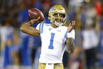 CORRECTS MONTH TO SEPTEMBER INSTEAD OF OCTOBER - UCLA quarterback Dorian Thompson-Robinson throws against Arizona in the first half of an NCAA college football game, Saturday, Sept. 28, 2019, in Tucson, Ariz. (AP Photo/Rick Scuteri)