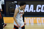 Oklahoma State guard Cade Cunningham (2) reacts to hitting a three-point basket against Oregon State during the second half of a men's college basketball game in the second round of the NCAA tournament at Hinkle Fieldhouse in Indianapolis, Monday, March 22, 2021. (AP Photo/Paul Sancya)