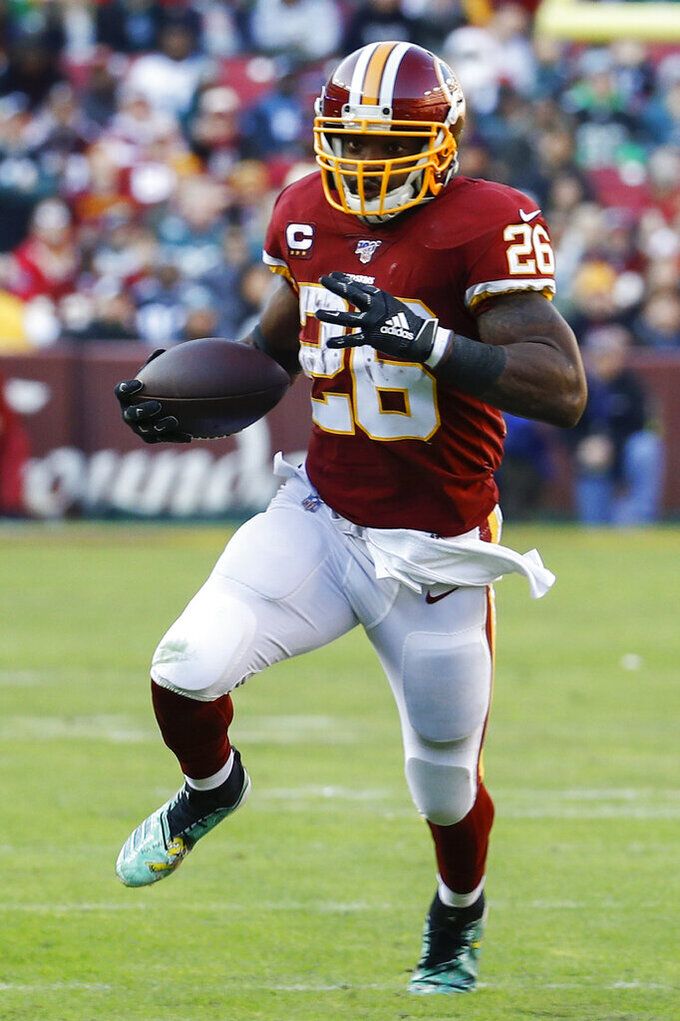 Washington Redskins running back Adrian Peterson (26) runs with the ball in the first half of an NFL football game against the Philadelphia Eagles, Sunday, Dec. 15, 2019, in Landover, Md. (AP Photo/Patrick Semansky)