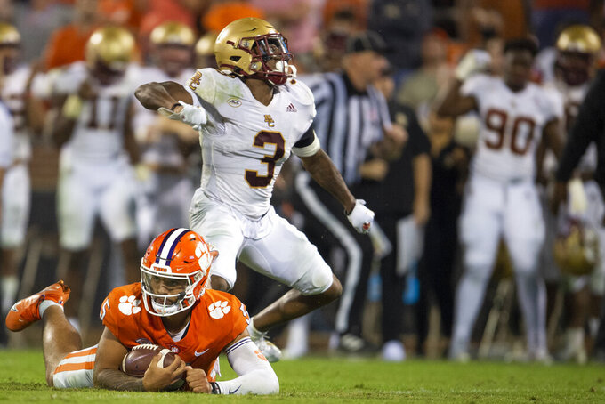 Boston College defensive back Jason Maitre (3) reacts after sacking Clemson quarterback D.J. Uiagalelei (5) during the second half of an NCAA college football game Saturday, Oct. 2, 2021, in Clemson, S.C. (AP Photo/Hakim Wright Sr.)