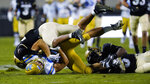 Colorado safeties Isaiah Lewis, top left, and Derrion Rakestraw, right, pull down UCLA tight end Greg Dulcich after he caught a pass in the second half of an NCAA college football game Saturday, Nov. 7, 2020, in Boulder, Colo. (AP Photo/David Zalubowski)