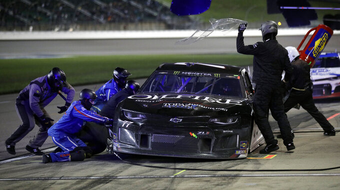 Quin Houff (77) pits during a NASCAR Cup Series auto race at Kansas Speedway in Kansas City, Kan., Saturday, May 11, 2019. (AP Photo/Orlin Wagner)
