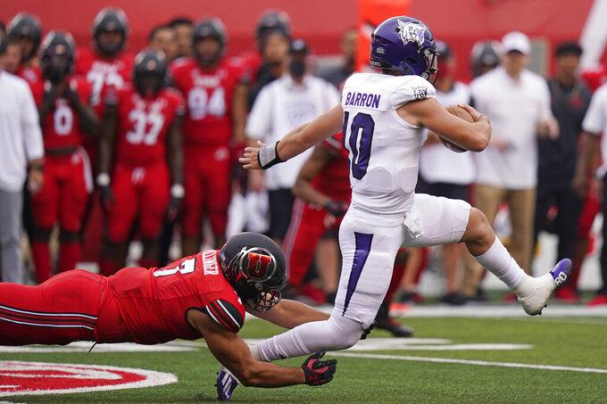 Utah defensive end Van Fillinger (7) tackles Weber State quarterback Bronson Barron (10) during the first half of an NCAA college football game Thursday, Sept. 2, 2021, in Salt Lake City. (AP Photo/Rick Bowmer)