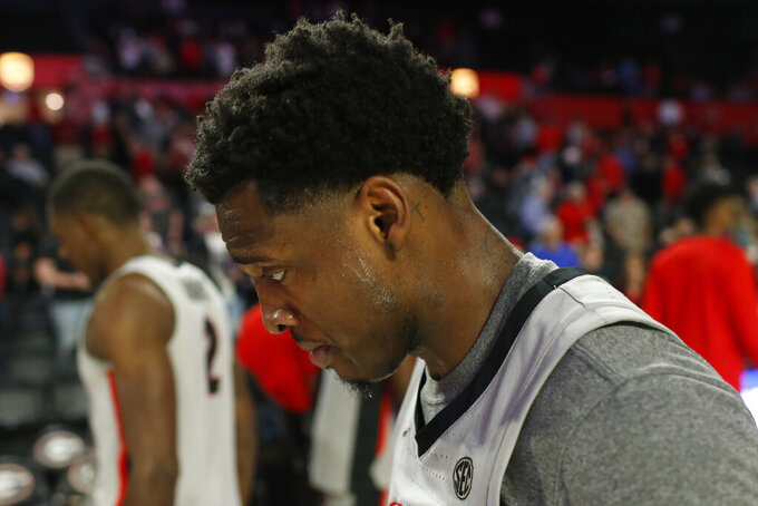Georgia's Tyree Crump leaves the court after the team's loss to South Carolina in an NCAA college basketball game Wednesday, Feb. 12, 2020, in Athens, Ga. (Joshua L. Jones/Athens Banner-Herald via AP)