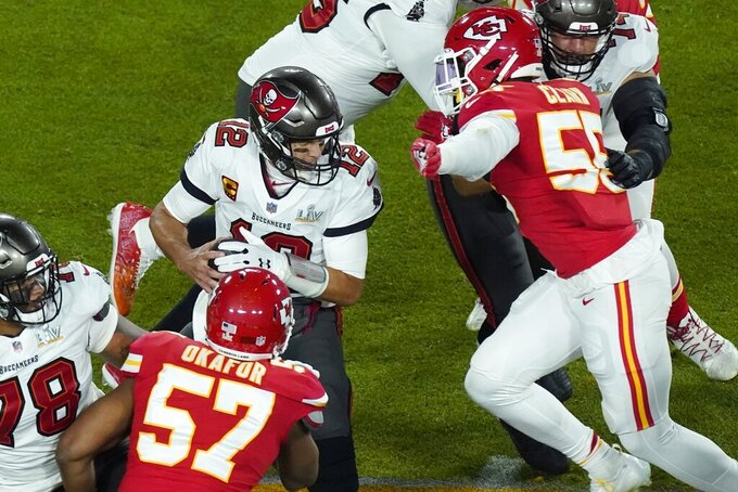 Tampa Bay Buccaneers quarterback Tom Brady (12) is sacked by Kansas City Chiefs' Frank Clark (55) during the first half of the NFL Super Bowl 55 football game Sunday, Feb. 7, 2021, in Tampa, Fla. (AP Photo/Charlie Riedel)