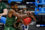 Ohio guard Lunden McDay (15) and Creighton guard Denzel Mahoney (34) get tangled up as they go for a rebound in the second half of a second-round game in the NCAA men's college basketball tournament at Hinkle Fieldhouse in Indianapolis, Monday, March 22, 2021. (AP Photo/Michael Conroy)