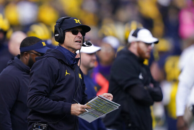 Michigan head coach Jim Harbaugh watches from the sideline during the second half of an NCAA college football game against Northwestern, Saturday, Oct. 23, 2021, in Ann Arbor, Mich. (AP Photo/Carlos Osorio)