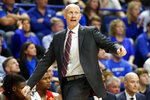 Louisville head coach Chris Mack directs his team during the second half of an NCAA college basketball game against Kentucky in Lexington, Ky., Saturday, Dec. 28, 2019. (AP Photo/James Crisp)