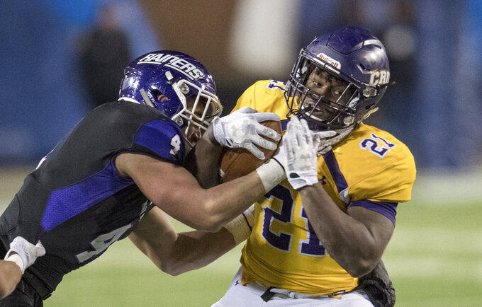 FILE - In this Dec. 15, 2017, file photo, Mount Union's Danny Robinson (4) tackles Mary Hardin-Baylor's Markeith Miller (21) during the Amos Alonzo Stagg Bowl NCAA Division III college football championship,  in Salem, Va. Robinson and Miller were named to The Associated Press Division III All-America Team, Thursday, Dec. 13, 2018. (AP Photo/Lee Luther Jr., File)