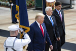 President Donald Trump, Vice President Mike Pence, and Defense Secretary Mark Esper arrive to place a wreath at the Tomb of the Unknown Soldier in Arlington National Cemetery, in honor of Memorial Day, Monday, May 25, 2020, in Arlington, Va. (AP Photo/Alex Brandon)