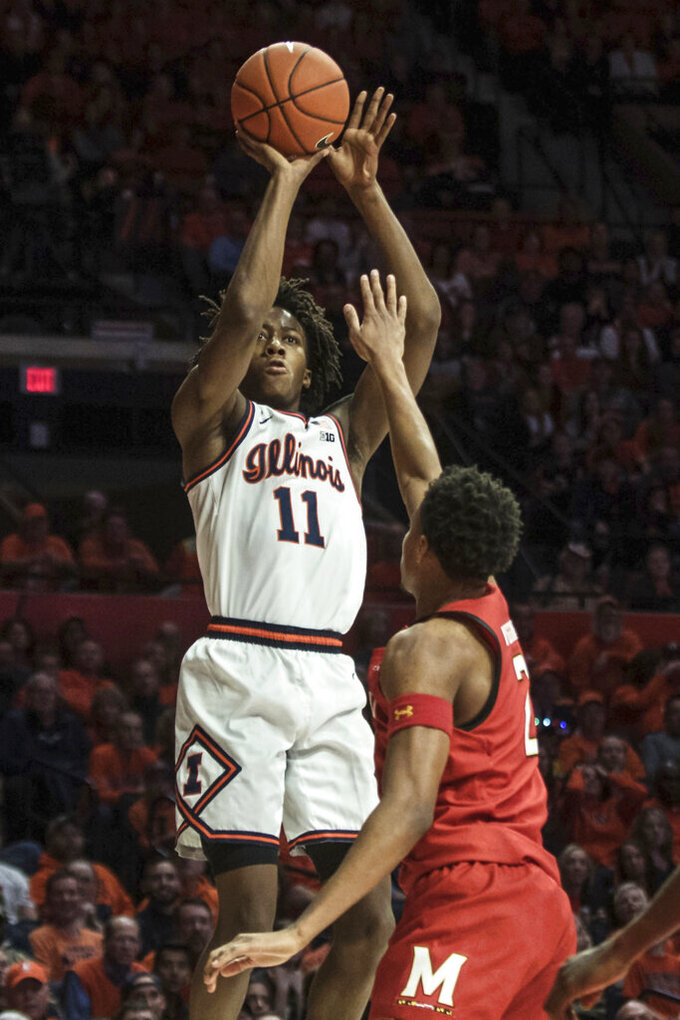 Illinois' Ayo Dosunmu (11) shoots over Maryland defender Aaron Wiggins (2) during the first half of an NCAA college basketball game Friday, Feb. 7, 2020, in Champaign, Ill. (AP Photo/Holly Hart)