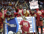 Iowa State players celebrate after defeating Kansas 78-66 in an NCAA college basketball game to win the Big 12 men's tournament Saturday, March 16, 2019, in Kansas City, Mo. (AP Photo/Charlie Riedel)
