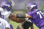 Minnesota Vikings tackle Brian O'Neill (75) blocks defensive end Danielle Hunter (99) during NFL football training camp Friday, July 30, 2021, in Eagan, Minn. (AP Photo/Bruce Kluckhohn)