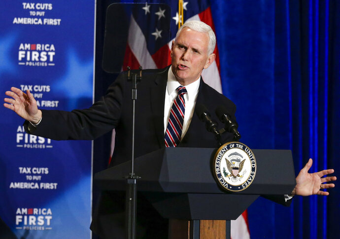 FILE - In this March 6, 2018 file photo, Vice President Mike Pence speaks at a event on tax cuts and the economy in Council Bluffs, Iowa. Pence is coming to one of the South's biggest street parties: the sprawling St. Patrick's Day parade in Savannah that's expected to draw 500,000 or more gaudy green revelers to the Georgia coast, Saturday, March 17. Mayor Eddie DeLoach plans to host Pence and members of the vice president's family Saturday, when locals and tourists toting plastic cups of beer will cram the sidewalks and oak-shaded squares along the 2.25-mile (3.6-kilometer) parade route through Savannah's downtown historic district. (AP Photo/Nati Harnik, File)